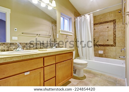 Beige Tone Bathroom Interior With Tile Wall Trim Vanity