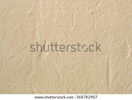 Beige tone color concrete wall, use for background