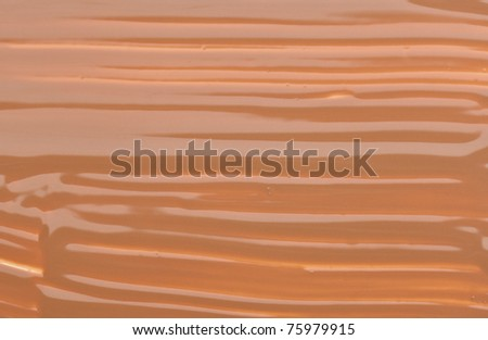 Beige tone cream (foundation) makeup, background texture - stock photo