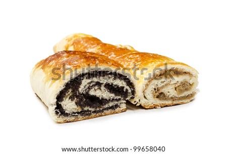 Beigli - hungarian poppy seed and walnut rolls closeup. - stock photo