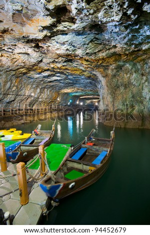 Beihai Tunnel, the former military tunnel designed to house equipment and personnel is now used as a tourist attraction with free boat rentals to tour the caves. - stock photo