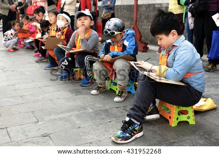 BEIJING - April 10, 2016 : A group of Chinese children have a class in a park - stock photo