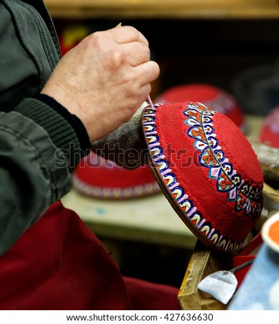 BEIJING - April 11, 2016: An artisan in China Making Cloisonne. Cloisonne become prevelent during the reign of Jing Tai period in the Ming Dynasty. - stock photo