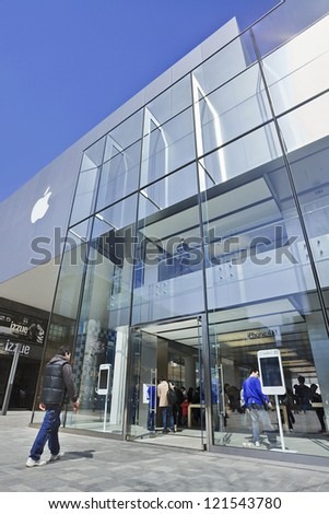 BEIJING-APRIL 3. Apple store in Beijing. In 2011, Apple sold 172 million iPods, iPhones and iPads. These post-PC devices making up a total of 76-percent of Apple's revenue. Beijing, April 3, 2012. - stock photo