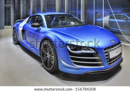 BEIJING-APRIL 17. Audi R8 in a showroom. Audi cars remain in high demand in US and China. Strong sales in those markets boosted Audi to new record for first eight months 2013. Beijing, April 17, 2013. - stock photo