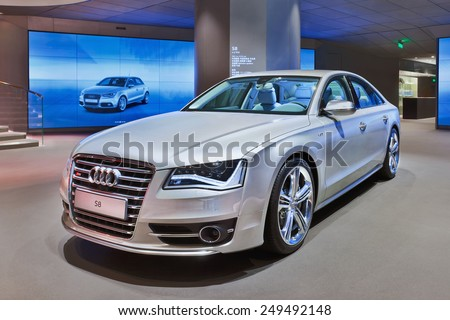 BEIJING-APRIL 16, 2013. Audi S8 in a showroom. In recent years non-German global brands like Cadillac, Lexus and Infiniti challenged the grip Audi, BMW and Mercedes-Benz maintain on China's market. - stock photo