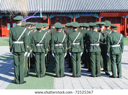 BEIJING - APRIL 2: Chinese soldiers prepare for the national flag ceremony on April 2, 2010 in Beijing, China. Here officers inspect soldiers.
