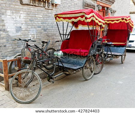 BEIJING - April 10, 2016:Typical Chinese rickshaw padicab, traditional transportation. Since the 1950s, when the pulled rickshaw was phased out, passengers may travel using three-wheeled pedicabs.