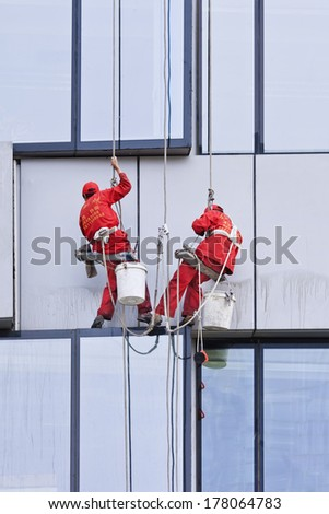 BEIJING - APRIL 28, 2009. Window cleaners at work. They are known as 'spider-men' because they often entrust their lives to a single thread, made of hemp and nylon thick as a gearstick.