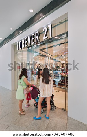 BEIJING-AUG. 21, 2015. Forever 21 outlet. The US fashion brand Forever 21, founded in 1984 and entered China in 2012, is quickening its expansion in China with plans to open more stores this year. - stock photo