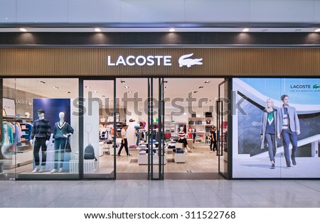 BEIJING-AUG. 21, 2015. Lacoste outlet. Lacoste is a French clothing company founded in 1933, it sells high-end clothing, footwear, perfume, leather goods, watches, eye-wear, and famous polo shirts.