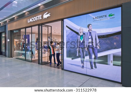 BEIJING-AUG. 21, 2015. Lacoste outlet. Lacoste is a French clothing company founded in 1933, it sells high-end clothing, footwear, perfume, leather goods, watches, eye wear, and famous polo shirts.  - stock photo