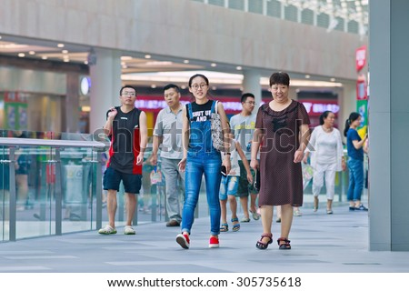 BEIJING-AUG. 2, 2015. Shoppers at Livat shopping mall. Owned by Inter Ikea Centre Group, Livat has more than 400 renowned domestic and international brands like H&M, Zara, Forever 21 and Old Navy. - stock photo