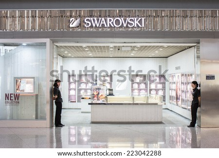 BEIJING - AUGUST 30: Swarovski Store at Beijing Capital Airport on August 30, 2014. Swarovski is an Austrian producer of luxury cut lead glass (crystal). - stock photo