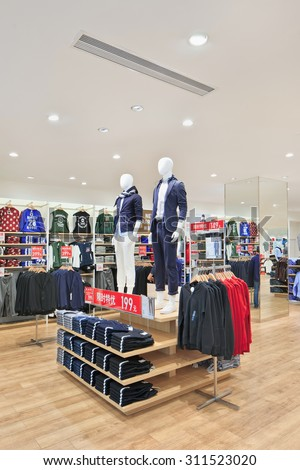 BEIJING-AUGUST 21, 2015. Uniqlo outlet interior. It opened its first store in mainland China in Shanghai in September 2002 and had steadily expanded its network to 306 stores at the beginning of 2015. - stock photo