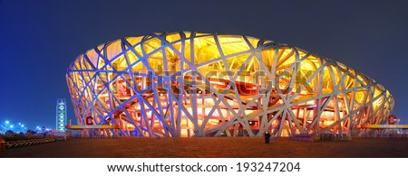 BEIJING, CHINA - APR 7: Beijing National Stadium at night on April 7, 2013 in Beijing, China. The stadium was established for the 2008 Summer Olympics and Paralympics. - stock photo