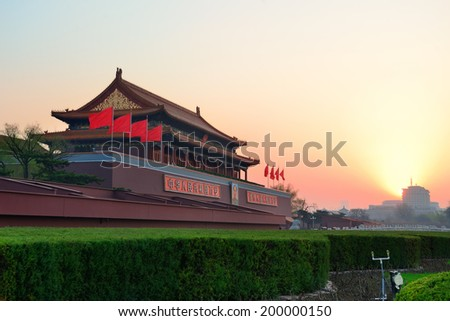 BEIJING, CHINA - APR 6: Tiananmen sunrise on April 6, 2013 in Beijing, China. Tiananmen is a famous monument in Beijing and serves as a national symbol. - stock photo
