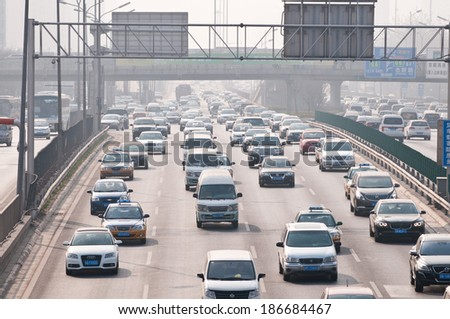 BEIJING, CHINA - APRIL 2: a lot of cars drive at The North 4th Ring Road Middle on April 2, 2013 in Beijing