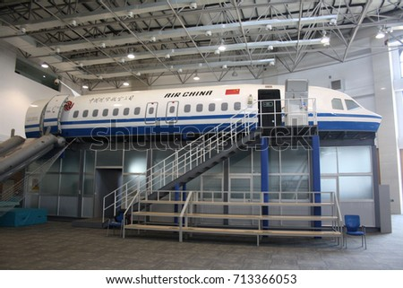 BEIJING, CHINA – APRIL 14 2015: An Air China emergency evacuation drill begins at its cabin crew training centre using a specially-built training aircraft with emergency slide deployed and doors open.