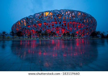 BEIJING,CHINA - APRIL 01 , 2011 : Bird's Nest is a Beijing National Stadium at night after rain in Beijing, China. The stadium was established for the 2008 Summer Olympics and Paralympics. - stock photo