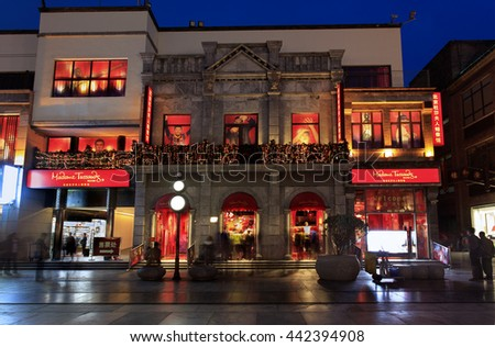 BEIJING, CHINA - APRIL 3, 2016: Madame Tussauds Museum at dusk; Madame Tussauds Beijing branch was opened in 2014 and it is located in Qianmen street, city downtown. - stock photo