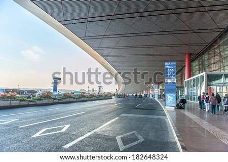 BEIJING,CHINA - APRIL 02 , 2011 : Passengers at departure building Beijing Capital Airport in China.The airport has registered 488,495 aircraft movements and ranked 10th in the world. - stock photo