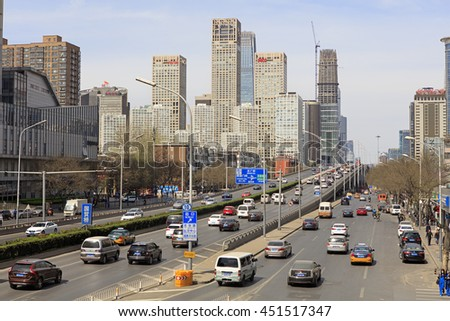 BEIJING, CHINA - APRIL 2, 2016: Skyline of modern skyscrapers and traffic are seen at downtown city