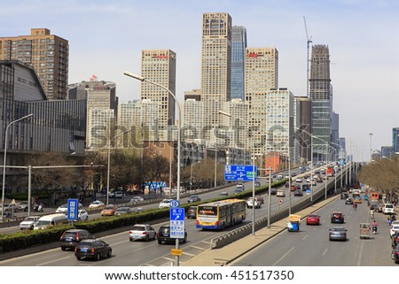 BEIJING, CHINA - APRIL 2, 2016: Skyline of modern skyscrapers and traffic are seen at downtown city - stock photo
