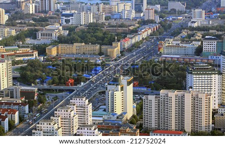 BEIJING, CHINA- AUGUST 22, 2010: Cityscape of Beijing city.  Beijing, the capital of the People's Republic of China, is the second largest Chinese city by urban population. - stock photo