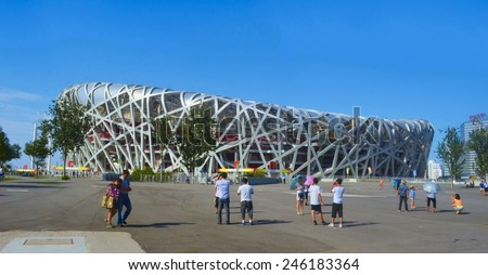 BEIJING, CHINA, AUGUST 20, 2013: people are walking in front of the birds nest olympic stadium in beijing. - stock photo