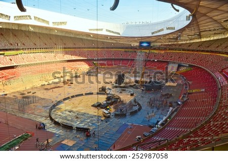 BEIJING, CHINA, AUGUST 20, 2013: workers are constructing new stage inside of the birds nest olympic stadium in chinese beijing. - stock photo