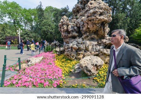 BEIJING, CHINA - CIRCA ARPIL 2014: People in the park at weekend in Beijing, China circa April 2014. - stock photo