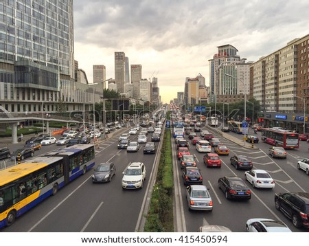 BEIJING, CHINA - CIRCA JUNE 2015, the view on the road highly loaded with traffic leading to Beijing's financial center Gumao on a sunny day in Beijing China - stock photo