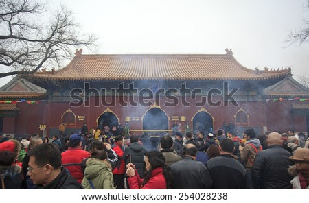 BEIJING, CHINA - FEBRUARY 19, 2015: People crowded Yonghegong Lama Temple on the first day of the Chinese Lunar New Year, the year of the sheep, which started on February 19 this year.   - stock photo