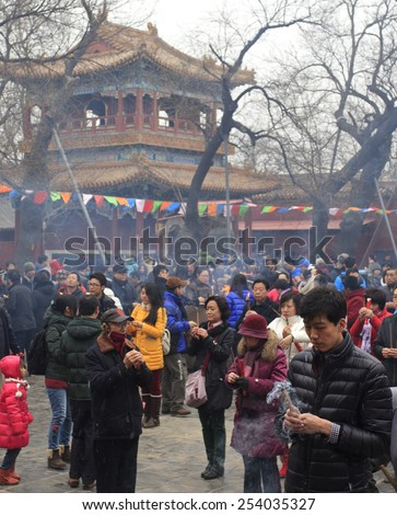 BEIJING, CHINA - FEBRUARY 19, 2015: People pray at Yonghegong Lama Temple on the first day of the Chinese Lunar New Year, the year of the sheep, which started on February 19 this year.