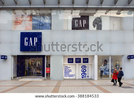 BEIJING, CHINA-FEBRUARY 21, 2016: Unidentified people walk nearby a Gap store; Gap is an American multinational clothing and accessories retailer. It operates more than three thousand stores worldwide