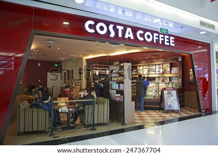 BEIJING, CHINA - JAN 18, 2015: Costa Coffee shop; Costa Coffee,  a British multinational coffeehouse company, is the second largest coffeehouse chain in the world and the largest in the United Kingdom - stock photo