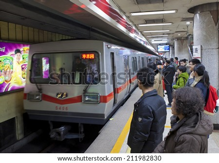 BEIJING, CHINA - JAN. 12, 2014: Crowded subway train. Any subway trip, costs only 2 yuan (33 US cents); Beijing government's  plans to reform the current low-cost subway ticket system - stock photo