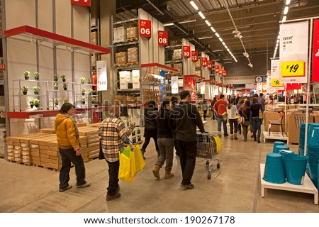 BEIJING, CHINA - JAN. 18, 2014:  Shoppers are seen at IKEA Xihongmen store; This store, opened in Nov. 2013, is the second store in Beijing and is the 14th store in China, after its debut in 1998 - stock photo