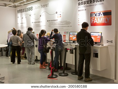 BEIJING, CHINA - JANUARY 18, 2014:  Customers are seen at IKEA Xihongmen store registration area; this store, opened in Nov. 2013, is the second store in Beijing and is the 14th store in China.  - stock photo