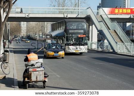 BEIJING, CHINA - JANUARY 6, 2016: ?ity bus and taxi ride on the street in Beijing.