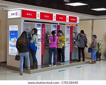 BEIJING, CHINA - JANUARY 12, 2014:  People is seen at a ICBC branch; Industrial and Commercial Bank of China Ltd. (ICBC) is the largest bank in the world by total assets and market capitalization  - stock photo