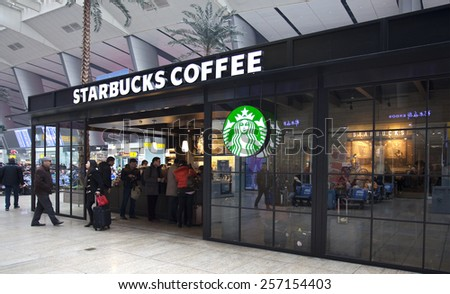 BEIJING, CHINA - JANUARY 29, 2015: People is seen at a Starbucks store. Starbucks is the largest coffeehouse company in the world, with 21,160 stores in 63 countries including 1570 in China.