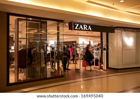 BEIJING, CHINA - JANUARY 2, 2014: People walk in a Zara store. Zara is one of the largest international fashion companies and it's the flagship chain store of the Inditex group. - stock photo