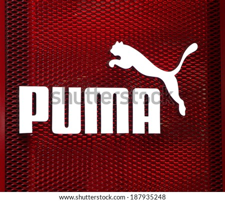 BEIJING, CHINA - JANUARY 22, 2014: Puma sign is displayed at the facade of a Puma Store; Puma, a major German multinational company, produces athletic and casual footwear, as well as sportswear. - stock photo