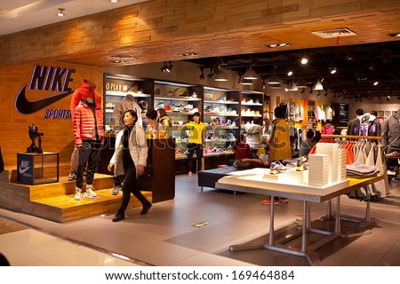 BEIJING, CHINA - JANUARY 2, 2013: Shoppers are seen at a Nike store; Nike Q2 profit rises 40%, on account of a rise in revenue across the globe, included growth in China. - stock photo