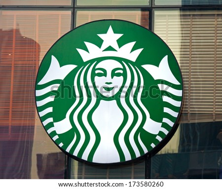 BEIJING, CHINA - JANUARY 22, 2014: Starbucks sign is displayed at the facade of a Starbuks store. Starbucks is the largest coffeehouse company in the world, with 20,891 stores in 62 countries - stock photo