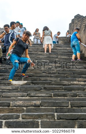 Beijing, China - Jul 18, 2015: People climbing the Great Wall of China