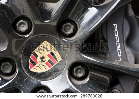 BEIJING, CHINA - JUNE 2015: Detail of the wheel of a Porsche Carrera car in Beijing on 21 June 2015. In 2014 Porsche had a sales record of 46,931 deliveries across Mainland China, Hong Kong and Macau.