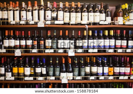 BEIJING,CHINA - MAR 23: Hualian supermarket shelves with wine on March 23th 2013 in Beijing. Hualian is China's first supermarket chains listed companies. - stock photo